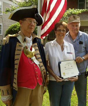 The Harry S. Truman Chapter recognized Bernard and Donna Camerlinck on Flag Day - 2011. The lifelong Independence resident and U.S. Marine veteran of the Vietnam War was honored as an example of someone who faithfully and properly flies the U.S. flag. MOSSAR Color Guard Commander Robert L. Grover and pending new member Chris Vedder, are shown here conducting a Flag Certificate Award presentation.  The Flag Certificate Award was recommended by Chris Vedder.