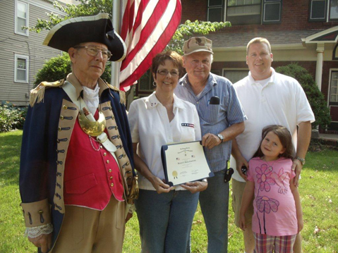 The Harry S. Truman Chapter recognized Bernard and Donna Camerlinck on Flag Day - 2011 on June 14, 2011. The lifelong Independence resident and U.S. Marine veteran of the Vietnam War was honored as an example of someone who faithfully and properly flies the U.S. flag. MOSSAR Color Guard Commander Robert L. Grover and pending new member Chris Vedder, are shown here conducting a Flag Certificate Award presentation. The Flag Certificate Award was recommended by Chris Vedder.