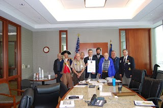 Historian Brian Smarker presented the Harry S. Truman Chapter with a proclamation signed by Kansas City Mayor Sly James, in honoring Major M.R. William Grebe, Medal of Honor recipient.  Major Grebe was honored on Sunday March 25, 2012 at his gravesite at Mount St. Mary's Cemetery, which is located at 2201 Cleveland Avenue, Kansas City, Missouri.  The proclamation was read at the ceremony on National Medal of Honor Day.