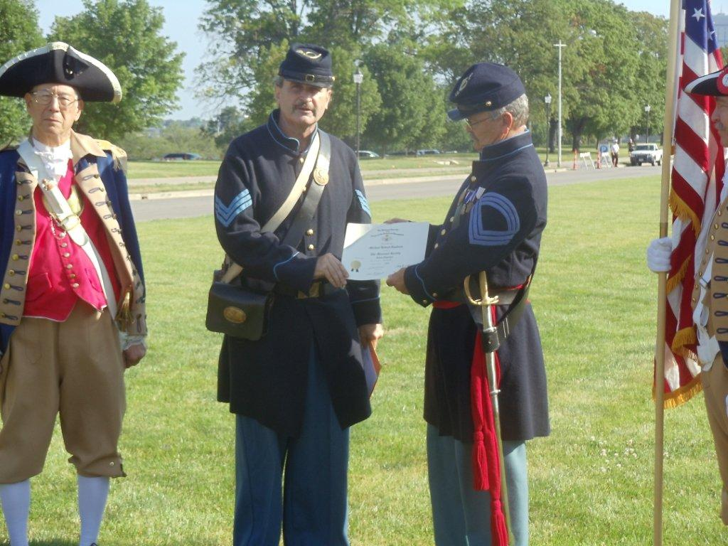 The Harry S. Truman Chapter inducted Compatriot Michael Lundeen at his Membership ceremony at the Liberty Memorial on Memorial Day, Monday, May 28th, 2012, in which President Dirk Stapleton presented Compatriot Lundeen with his membership oath and membership certificate. Compatriot Robert Grover acted upon behalf of sponsor David McCann, in which he pinned the NSSAR Rosette to Compatriot Lundeen's lapel.