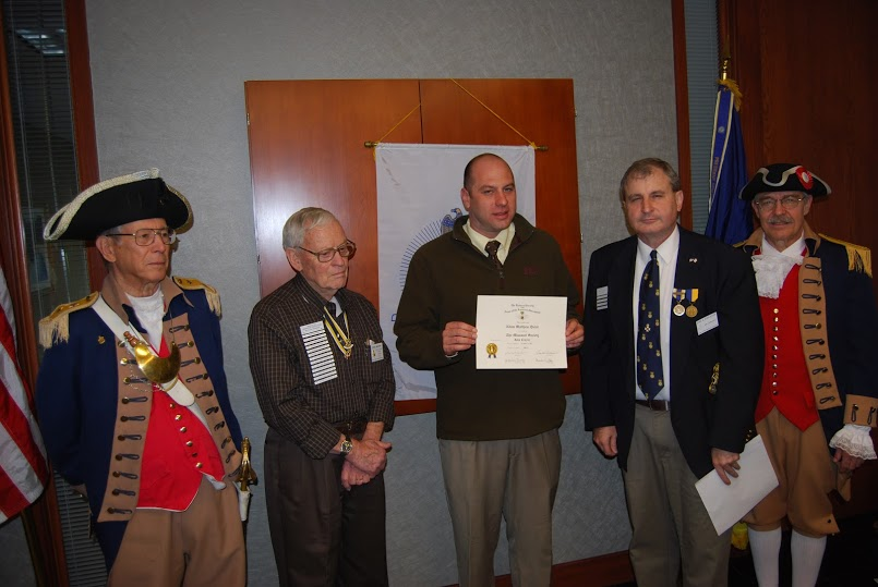 The Harry S. Truman Chapter inducted Compatriot Adam Matthew Quint into the ranks at the 331st Meeting on Saturday, January 12, 2013. President Dirk A. Stapleton and the Harry S. Truman Chapter Color Guard officiated during the ceremony.  President Dirk Stapleton presented CompatriotAdam Matthew Quint with his membership oath, membership certificate, and challenge coin.