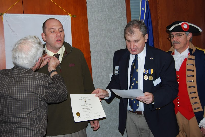 The Harry S. Truman Chapter inducted Compatriot Adam Matthew Quint into the ranks at the 331st Meeting on Saturday, January 12, 2013. President Dirk A. Stapleton and the Harry S. Truman Chapter Color Guard officiated during the ceremony.  President Dirk Stapleton presented Compatriot Adam Matthew Quint with his membership oath, membership certificate, and challenge coin.