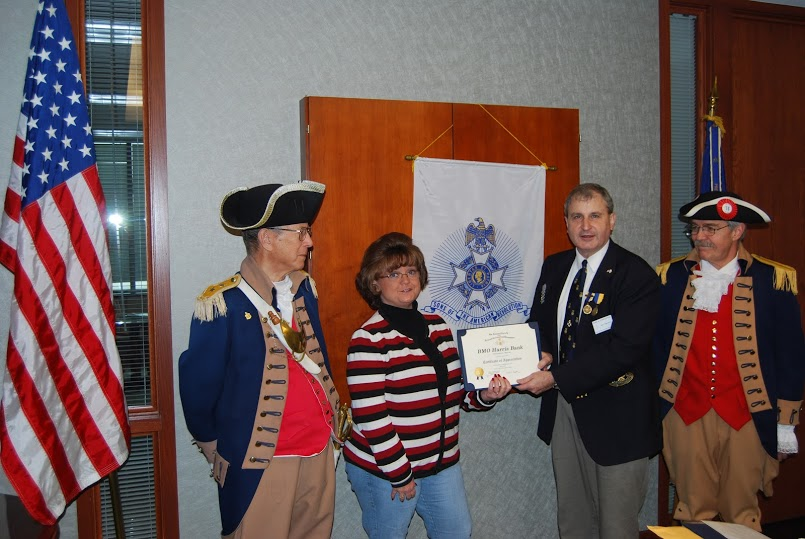 President Dirk Stapleton presented BMO Harris Bank, N.A. branch representative Ms. Sherry Ring, with a Certificate of Appreciation and a HST Chapter Challenge Coin at the January 12, 2013 meeting.  President Stapleton recognized BMO Harris Bank, N.A  for their support and dedication in allowing the Harry S. Truman Chapter to meet at their facility on a monthly basis.  The monthly meetings are held at BMO Harris Bank, N.A., 18811 E. Valley View Pkwy, Independence, MO 64055-7010.
