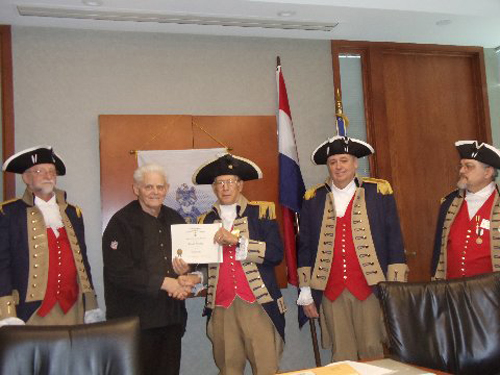Compatriot Reginald Day was presented with a supplemental ancestor certificate for Patriot Edgar Poe by Vice President Robert Grover. Congratulations Compatriot Reginald Day.