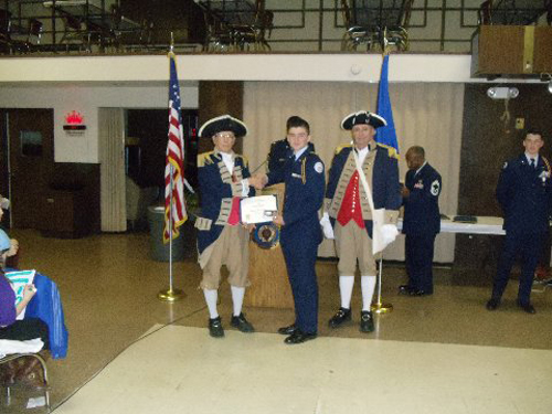 The Harry S. Truman Chapter Color Guard is shown here presenting a Junior Reserve Officer Training Corps Award to Air Force JROTC Cadet Bless, at American Legion Post #499, on Thursday, April 17, 2014. MOSSAR Color Guard Commander Robert Grover, presented Air Force JROTC Cadet Bless with the J.R.O.T.C. Award.