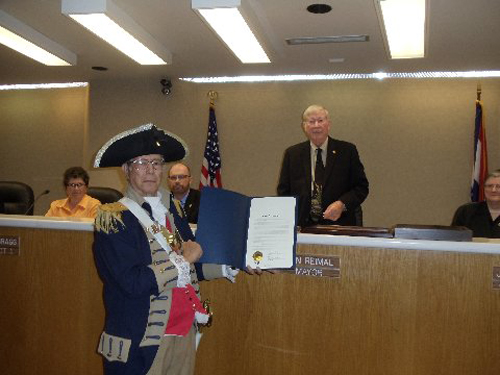 Pictured here is Harry S. Truman Chapter Member Robert L. Grover  along with Independence Mayor Don Reimal after signing the 125th SAR Proclamation Anniversary for MOSSAR and the Harry S. Truman Chapter.