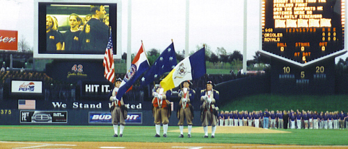 The MOSSAR Color Guard team is shown performing before an audience prior to the start of the Kansas City Royals Baseball game on Friday evening, April 26, 2002.  It is believed to be the first time that the Headquarters Flag has flown before any professional event