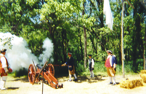 MOSSAR Color Guard team at Pomme de Terre Dam in Hermitage, MO on May 4 -5, 2002.  Shown here, Robert Grover firing a 3 pound cannon; James L. Scott observing></CENTER><br>  <CENTER><FONT size=
