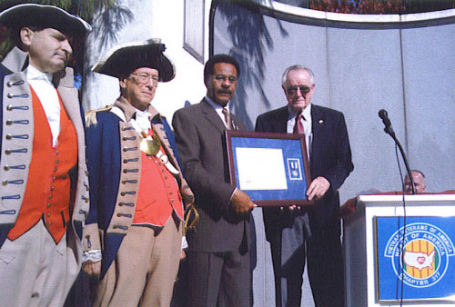 Pictured here is the distinguished guest Congressman Emanuel Cleaver II, Compatriot Romie Carr, and the MOSSAR Color Guard Team on Veterans Day 2009. Compatriot Romie Carr, who is a Vietnam veteran, and on behalf of MOSSAR, presented the SAR Silver Good Citizenship Medal to U.S. Representative Emmanuel Cleaver at the Vietnam Memorial on Veterans Day.  It was an excellent speech by Compatriot Carr, who presented Representative Cleaver the framed medal with certificate