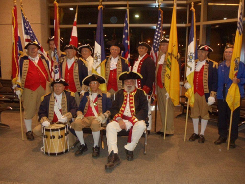 Pictured here is the MOSSAR and KSSSAR Color Guard teams from the Kansas City area, who are shown here at the Honor Flight Greeting for WW II Veterans at Kansas City International on Wednesday evening, May 1, 2013. WW II Veterans were all smiles as they disembarked from the return flight.