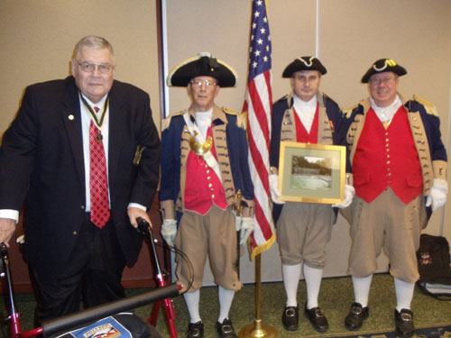 Shown here in this photo, is MOSSAR State President Denis Craft and  Major General Robert Grover, MOSSAR Color Guard Commander; presenting Western Color Guard Commander James L. Scott and Compatriot Dirk Stapleton, with a Certificate of Appreciation and photo from the Vietnam Veterans of America, Heart of America Chapter The presentation was conducted at the MOSSAR Board of Directors Meeting, held at the Courtyard By Marriott Convention Center in Columbia, Missouri on Saturday, January 28, 2012.