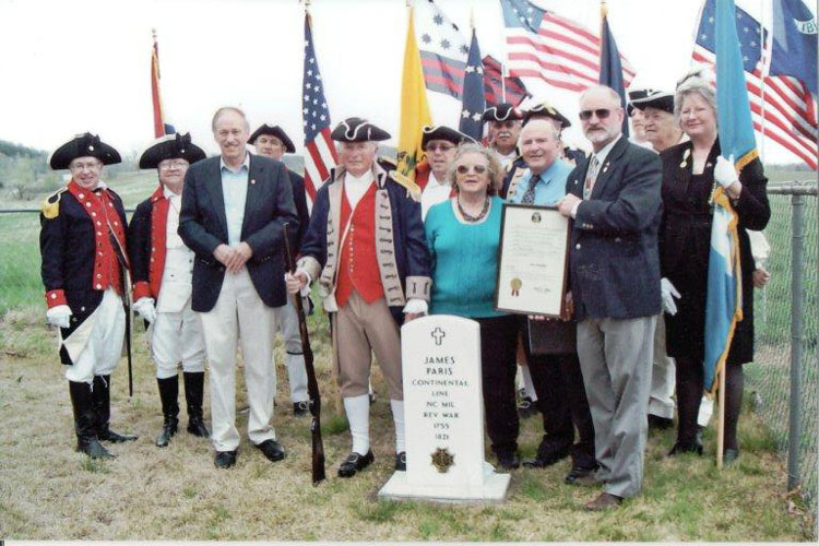 Shown here is the MOSSAR Color Guard Team who participated in a Grave Marker Dedication Ceremony for American Revolution War Patriot James Paris on Saturday, March 24, 2012, where he is buried in the Crawford-Sims Cemetery, which is on Route O between Hannibal, Missouri and New London, Missouri.  State Sen. Brian Munzlinger, displays a resolution honoring Revolutionary War veteran James Paris to Paris' sixth-generation descendants.