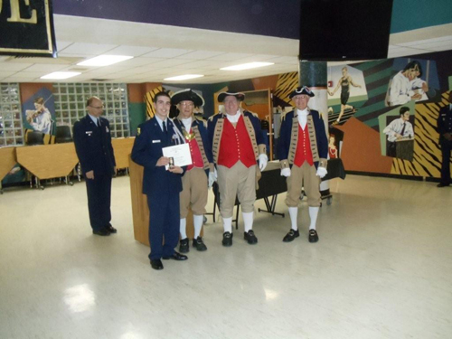 The MOSSAR Color Guard is shown here presenting a Junior Reserve Officer Training Corps Award to Air Force JROTC Cadet Alex Ballard, at Lee's Summit High School, on Monday, April 11, 2011. The MOSSAR Color Guard along with MOSSAR Color Guard Commander Robert Grover, presented Air Force JROTC Cadet Alex Ballard with the J.R.O.T.C. Award.