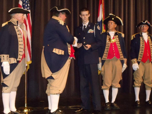 The MOSSAR Color Guard is shown here presenting a Junior Reserve Officer Training Corps Award to Air Force JROTC Cadet Connor Smith, at Lee's Summit West High School, on Tuesday, April 12, 2011. The MOSSAR Color Guard along with MOSSAR Color Guard Commander Robert Grover, presented Cadet Connor Smith with the J.R.O.T.C. Award.