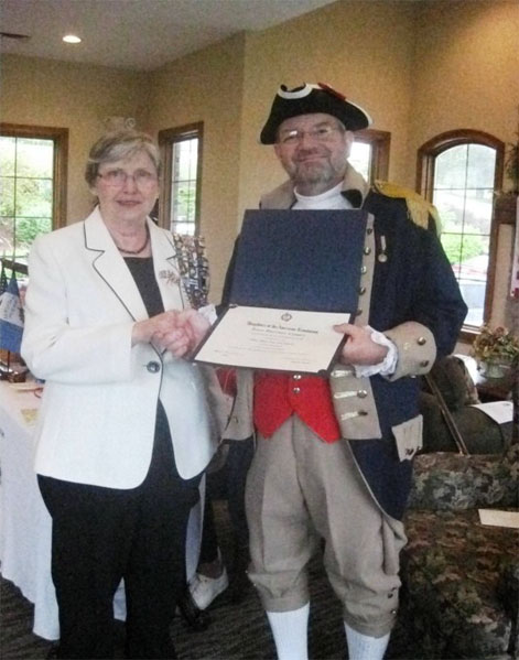 MOSSAR Color Guard member Compatriot Mel McNeal is shown here receivng a Certificate of Appreciation as guest speaker on Saturday April 14, 2012,  in Nixa, Missouri.  The certificate was presented by Isaac Garrison Chapter Regent Linda L. Oeser.