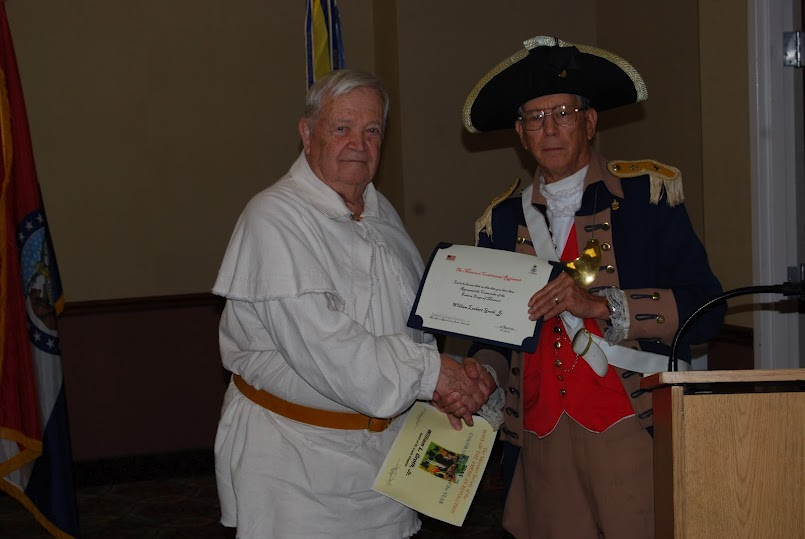 Pictured here is Major General Robert L. Grover, MOSSAR Color Guard Commander, presenting the MOSSAR Color Guardsman Award of the Year for 2011 to Compatriot William Groth. The presentation was conducted at the 122nd Annual Missouri State Convention in Branson, Missouri on April 28, 2012.