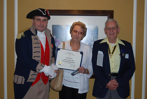 Pictured here is Harry S. Truman Chapter President Dirk A. Stapleton, Mrs. Shirley McCann, and Compatriot David McCann.