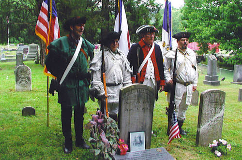 Pictured here with the National Society Daughters of the American Revolution, is the WVSSAR and MOSSAR Color Guard Teams on Saturday, July 1 2006. The team participated in the grave marking ceremony of Revolutionary War Soldier Adam Flesher.  Patriot Adam Flesher is buried in the Riverside Cemetery in Weston, West Virginia.
