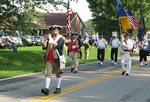 Pictured here is the MOSSAR Color Guard team is shown here marching in the Battle of Lone Jack Parade, Lone Jack, MO on August 16, 2014.