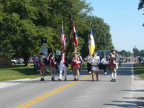 The MOSSAR Color Guard team is shown here marching in the Battle of Lone Jack Parade, Lone Jack, MO on August 17, 2013. After the Battle of Lone Jack Parade, President Harry S. Truman (Raymond Starzmann) was the guest speaker for the 50th Anniversary Battle of Lone Jack Museum Dedication.