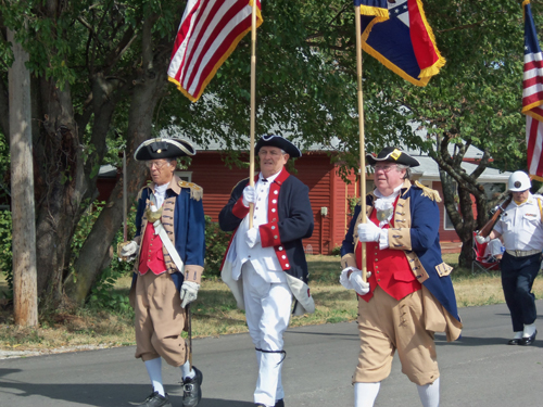 The MOSSAR Color Guard team is shown here marching in the Battle of Lone Jack Parade, Lone Jack, MO on August 18, 2012. Other events included the Battle of Lone Jack reenactment on Saturday - Sunday, August 18-19, 2012. The actual reenactments were held on a farm two miles from Lone Jack.