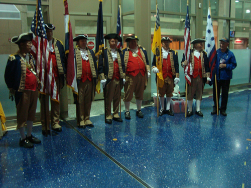 Pictured here is the MOSSAR Color Guard team from the Kansas City area, who are shown here at the Honor Flight Greeting for WW II Veterans at Kansas City International on Tuesday evening, October 16, 2012. WW II Veterans were all smiles as they disembarked from the return flight.