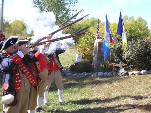 The MOSSAR Color Guard Musket Firing team is shown here during the Rededication of DAR Marker, for the Drover Inn Site near Williamsburg, Missouri just east of Columbia, Missouri on B Highway North, Sunday, October 27, 2013.
