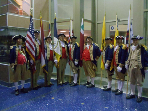 Pictured here is both the MOSSAR and KSSSAR Color Guard Teams, from the Kansas City area, who are shown here at the Honor Flight Greeting for WW II Veterans at Kansas City International on Wednesday evening, November 7, 2012. WW II Veterans were all smiles as they disembarked from the return flight.