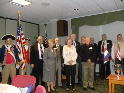 The MOSSAR Color Guard is shown here participating on Monday, December 5, 2011 in a Holiday Luncheon commemorating the 70th Anniversary of Pearl Harbor. The luncheon was held at Kingswood Manor in Kansas City, MO. The guest speaker was Rear Admiral (Ret.) J. Stanton Thompson.