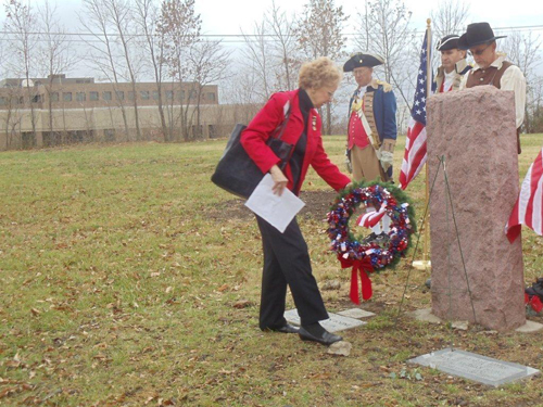 Lavone Anglen, President of the United Daughters of 1812 is shown here laying a wreath at the grave marker of Captain Daniel Morgan Boone, in honor for his service to our country in the bicentennial year of the War of 1812, which was held on Saturday, December 15, 2012. President Brian Smarker, of the Captain Daniel Morgan Boone Chapter of the Society of the War of 1812; officiated the grave marker dedication ceremony.