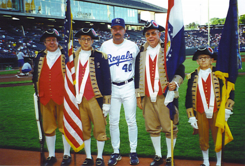 The MOSSAR Color Guard team is shown here along with the Kansas City Royals Baseball Coach Tony Muser prior to the start of the Kansas City Royals and Chicago game on May 5, 2000