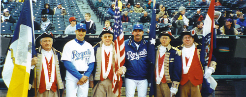 The MOSSAR Color Guard team is shown here with two members of the Kansas City Royals Baseball team prior to the start of the game on Friday, April 26, 2002