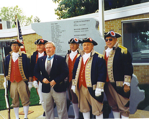Donald E. Ballard, Medal of Honor recipient and the MOSSAR Color Guard team attend the Missouri Wall of Valor at the Harry S. Truman Memorial Veterans Hospital, in Columbia, MO on October 16, 2002. The Memorial is dedicated to the 63 Medal of Honor recipients from Missouri