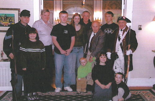 Mr. Robert King (veteran of World War II), Harry S. Truman Chapter President Rommie Carr (veteran of the Korean War), Mr. Dennis Owens (veteran of the Vietnam War), MOSSAR Color Guard members Captain Russell F. DeVenney, Jr. and Compatriot Dirk Stapleton (veteran of the Iraq War), and the Corps of Discovery Society of the Children of the American Revolution in Kansas City, MO are are shown here during a Corps of Discovery Society Veterans Day Program on November 20, 2005