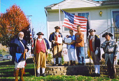 Pictured here is a Flag Certificate Award be presented on Veterans Day 2006 by the MOSSAR Color Guard team at the home of Joe and Marsha Tronstad and son Michael during a Flag Certificate Award presentation on November 11, 2006