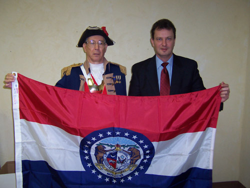 Major General Robert L. Grover, MOSSAR Color Guard Commander is shown here with State Senator Victor E, Callahan, 11th Senatorial District. Senator Callahan provided the MOSSAR with two proclamations and  the Missouri State Flag, which flew over the Capital of Missouri for Missouri Society Sons of the American Revolution.