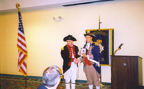 Pictured here is Captain Russel F. DeVenney, Jr., MOSSAR 1st Vice President, receiving the Bronze Color Guard Medal from Major General Robert L. Grover, MOSSAR Color Guard Commander