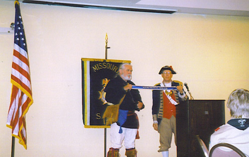Compatriot Francis R. Roberson Jr. is shown here with Major General Robert L. Grover, MOSSAR Color Guard Commander, displaying the Yorktown banner that Compatriot Roberson received while attending the 225th Anniversary of the Victory at Yorktown, Virginia.  Compatriot Roberson participated in the wreath laying ceremony on October 19th, 2006