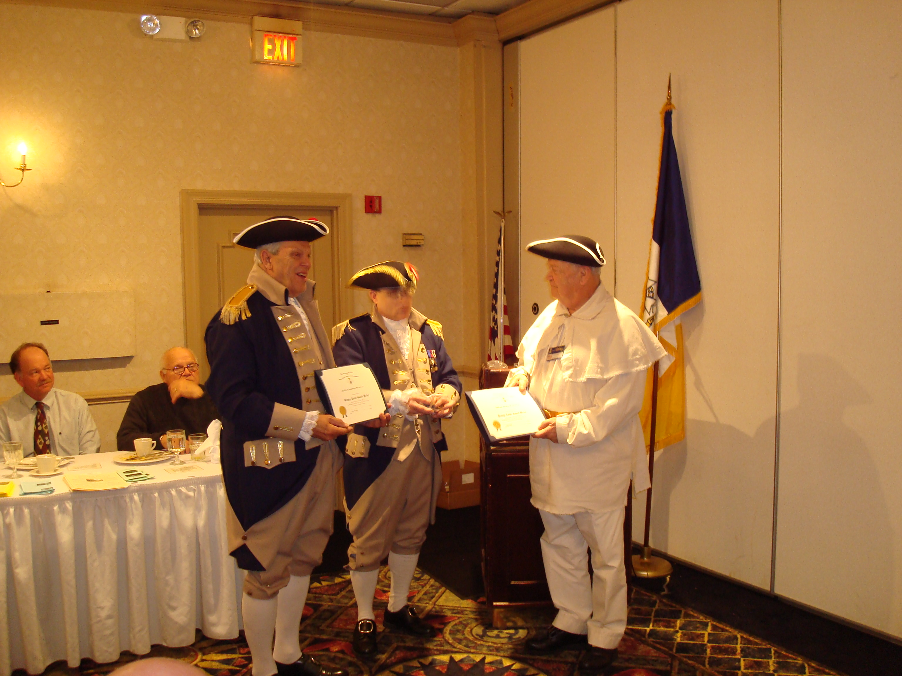 Brigadier General Stephen Baldwin, Eastern Commander, Missouri Continental Militia is shown here awarding the Bronze Color Guard Medal Award to Comparriots Keith Brown and William Groth at the Spirit of St. Louis Chapter meeting on 15 March 2008.