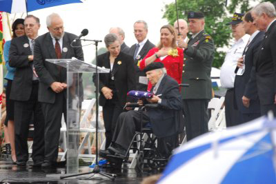 This year's ceremony allowed Missourians to salute and present a flag to native son Frank W. Buckles, who at age 107 is the last known U.S. veteran of World War I.