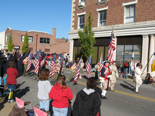In the left photo, the Allen Laws Chapter, Cape Girardeau, MO, and the MOSSAR Color Guard are shown here participating in the annual Cape Girardeau, MO Parade on Saturday, November 1, 2008 along with Boy Scout Troop 5 who assisted by carrying 27 Flags.  In addition, there was a truck with MOSSAR banners behind the MOSSAR Color Guard carrying MOSSAR members (NOT VISIBLE).