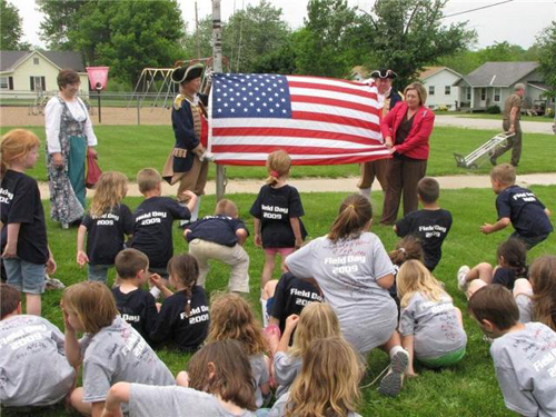 The MOSSAR Color Guard Teams participated in a Flag Raising at the Lone Jack, Missouri Elementary School in Lone Jack, MO on Friday, May 15, 2009. The Independence Pioneers DAR Chapter coordinated to have the flag flown originally over the United States Capital Building and then subsequently donated the flag to the Lone Jack, Missouri Elementary School. In addition, the Independence Examiner on May 20, 2009 published this news story on page A-7. All three DAR members, including Regent Independence Pioneers Chapters Linda Sehart, provided information about the U.S. Flag.