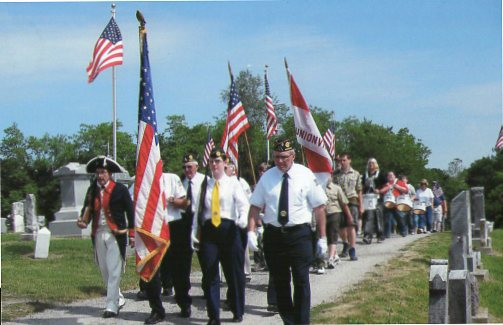 Shown here leading the Memorial Day Parade was Compatriot Carold Bland, who was dressed in American Revolution uniform.  Compatriot Carold Bland, a member of the Corporal Braxton C. Pollard Chapter, Missouri Society of the Sons of the American Revolution, in Unionville, MO, is the oldest MOSSAR Color Guard member. Compatriot Carold Bland is also Past President of the Corporal Braxton C. Pollard Chapter.