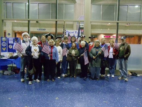 Pictured here is the MOSSAR Color Guard team and several DAR Chapters from the Kansas City area, are shown here at the Honor Flight Greeting for WWII Veterans at Kansas City International on Wednesday evening, November 3, 2010.