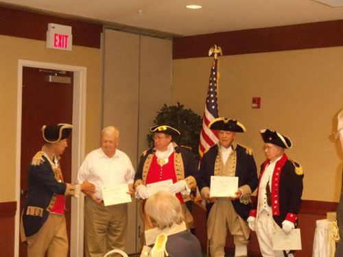 Shown here in this photo, is  Major General Robert Grover, MOSSAR Color Guard Commander; presenting subordinate Color Guard Commanders from each district of Missouri, with a Certificate of Appreciation. The presentation was conducted at the MOSSAR Board of Directors Meeting, held at the Courtyard By Marriott Convention Center in Columbia, Missouri on Saturday, July 30, 2011.