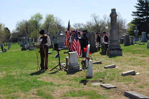 President Brian Smarker, President of the Captain Daniel Morgan Boone Chapter,Society of the War of 1812, is shown here reading a Proclamation signed by Kansas City Mayor Sly James, during a recognition ceremony for Civil War Medal of Honor recipient, Major M.R. William Grebe, buried at Mount St. Mary's Cemetery in Kansas City, Missouri.