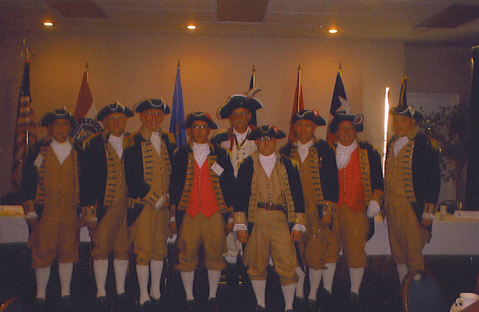 Changing of the Guard - SCD Color Guard Command changed at the 2002 SCD Meeting. Richard F. Arnold, Texas Society Color Guard Commander, turned over the spontoon to Robert L. Grover, Missouri Society Color Guard Commander